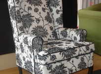 custom-black-and-white-wing-chair-contrast-piping-show-legs