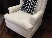 custom-linen-wing-chair-with-top-stitching-show-legs
