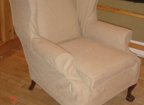 custom-wing-chair-covered-orig-leather-show-legs